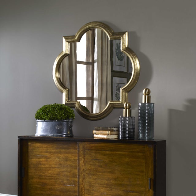 THis large quatrfoil mirror is a stunner! Wonderfully clad in antique brass applied over a solid wood frame and heavily...