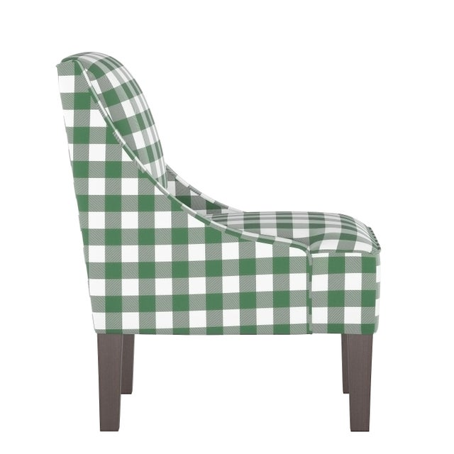 A chic seat inspired by iconic wingback designs, the Fulton Chair features sweeping arms that descend into a well-...