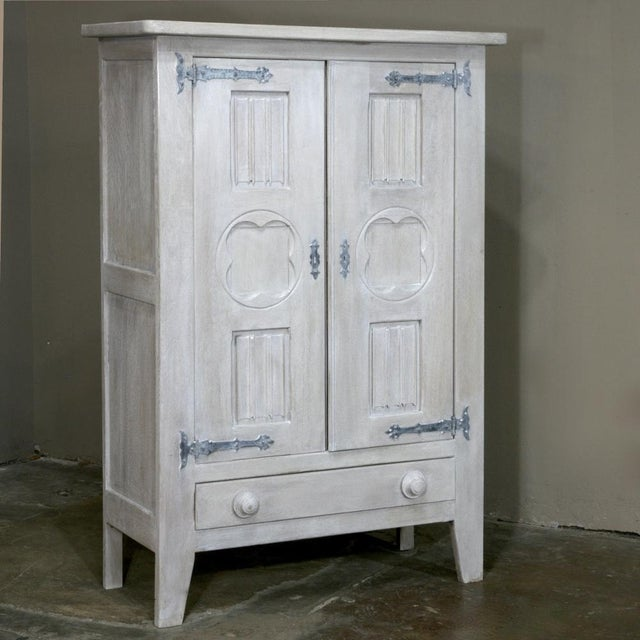 Antique Rustic Country French Painted Gothic Cabinet features beautifully whitewashed cabinet, elegantly decorated with...