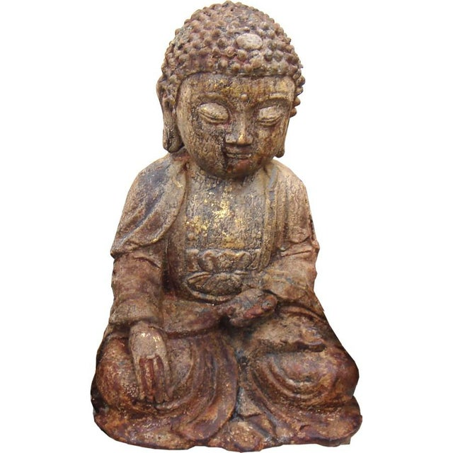 This Buddha statue was crafted from brass in China.