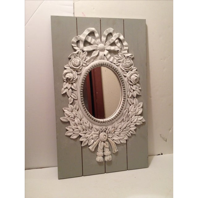 Gray and white shabby chic wood mirror with a French style design. Ribbon top, with roses and many petals. Might be a kind...