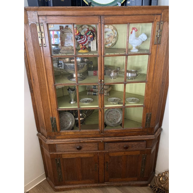 Charming Pine Corner Cabinet from the estate of Paul Gilbert of Gilbert/Robinson Restaurant Group. Perfect for display as...