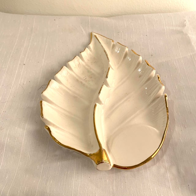 Classic white and gold elegance. This leaf shaped catchall or ashtray from the 1970's is marked California pottery.