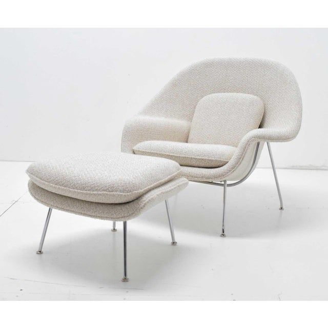 Eero Saarinen for Knoll Upholstered Womb Chair and Ottoman on metal legs. Newly upholstered in a Groundworks fabric that...