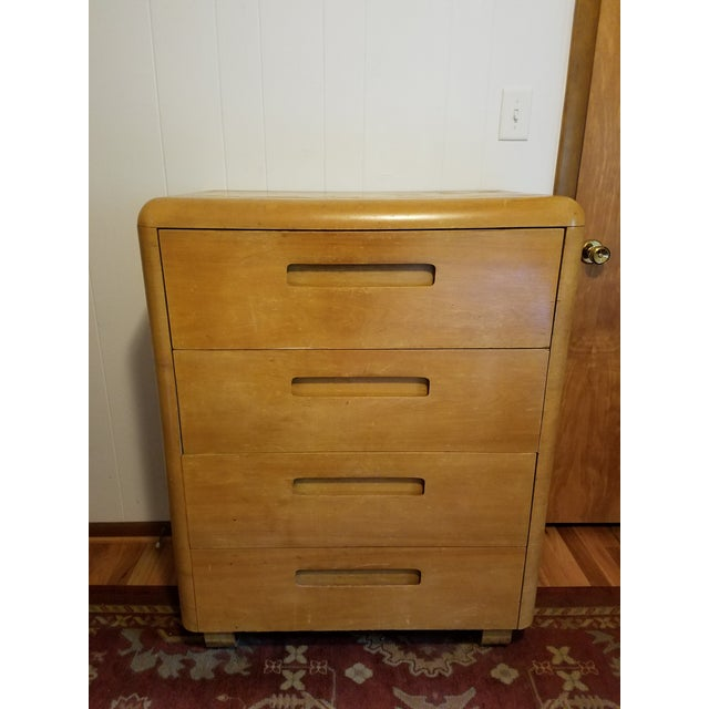 This light colored rounded corner dresser is perfect storage . The sled rail style feet just add to its charm.