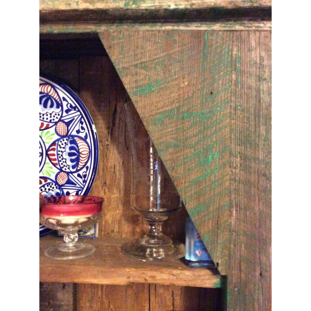 Primitive green hutch with much character. Very stable, distress and rustic, great for the mountain decor.