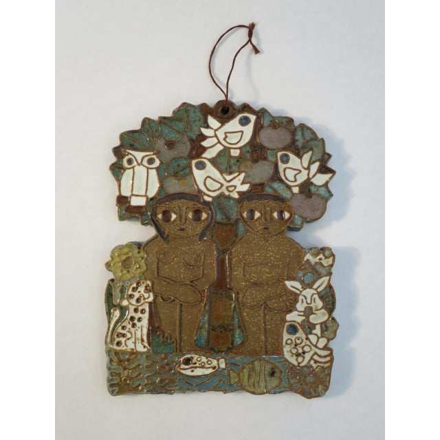 This is a vintage ceramic wall plaque by St. Andrew's Priory Pottery. It depicts Adam and Eve. The piece is in very nice...