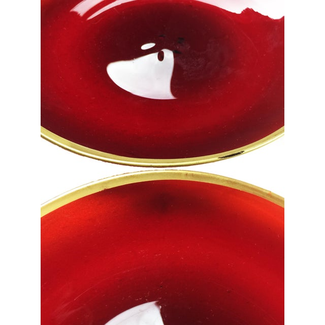 Vintage set of 4 small hand blown and hand painted ruby red glass plates with gold rim. It is hard to find glassware from...