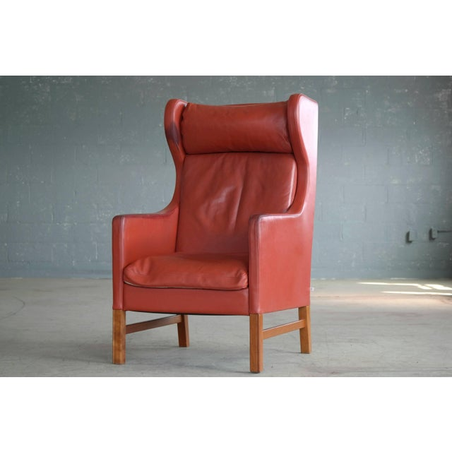 Elegant and eye-catching wingback armchair model Admiral designed by Erik Marquardsen and Takashi Okamura for Svend...