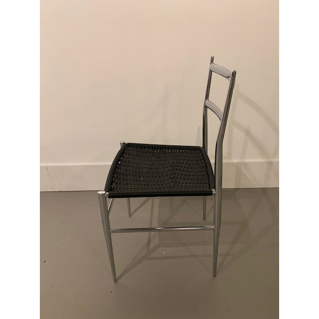 Sleek and stylish Gio Ponti chrome frame Leggera dining / side / desk chair with black vinyl wire woven seat (multiple...