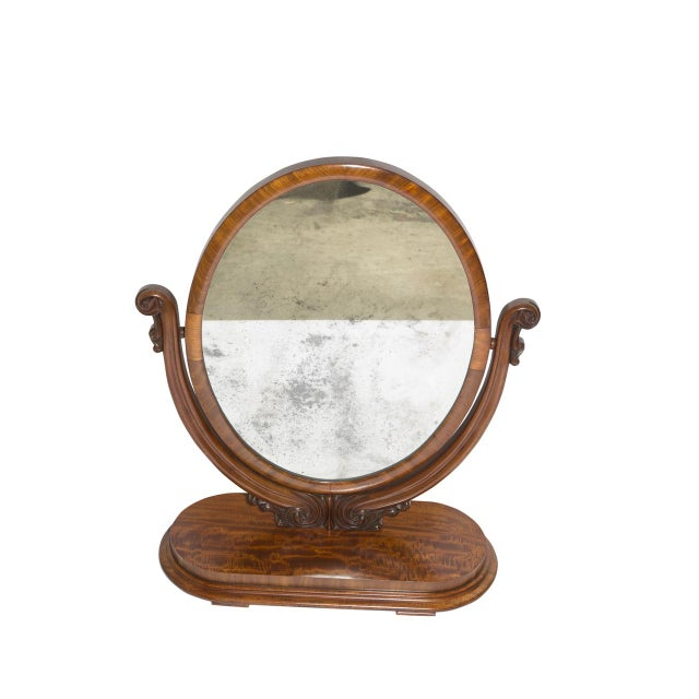 A large antique table mirror, perfect for a vanity or dresser. Antique mirror on stand in mahogany.