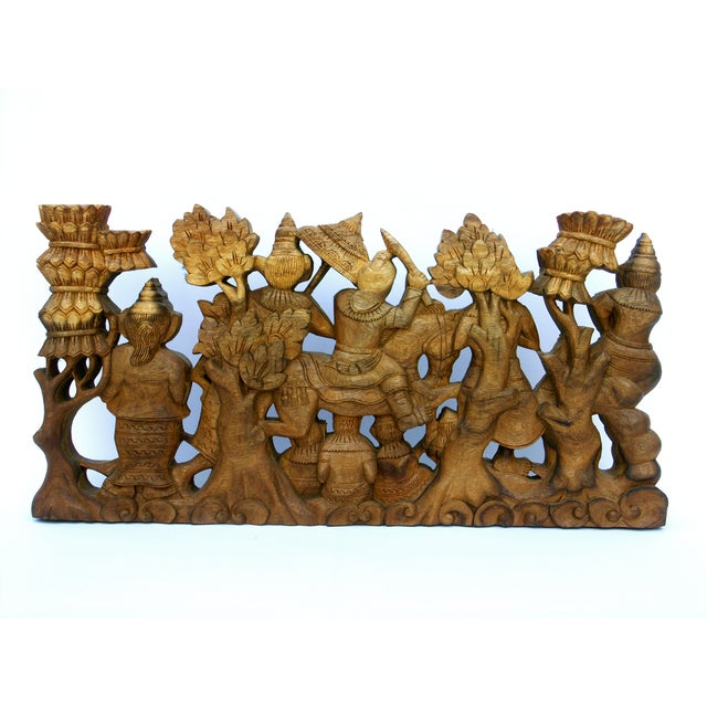 This charming and intricate, two-sided, wood carving is handmade by a skilled craftsman in Bali, Indonesia. It is made of...