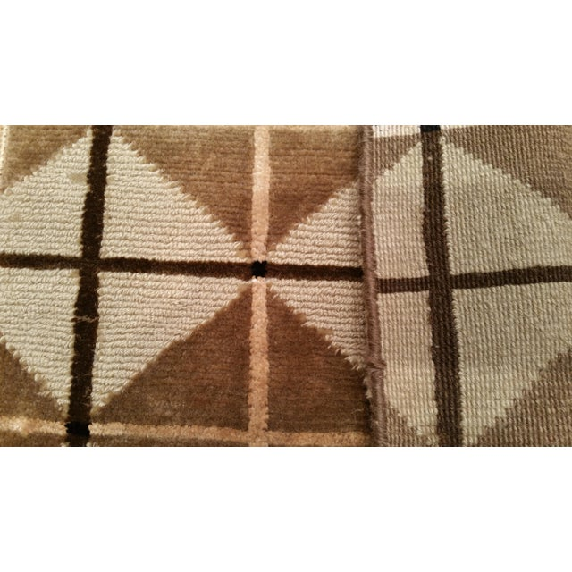 Infuse a touch of beauty to high-traffic areas of your home with this durable Modern rug in colors of beige, gold, brown....