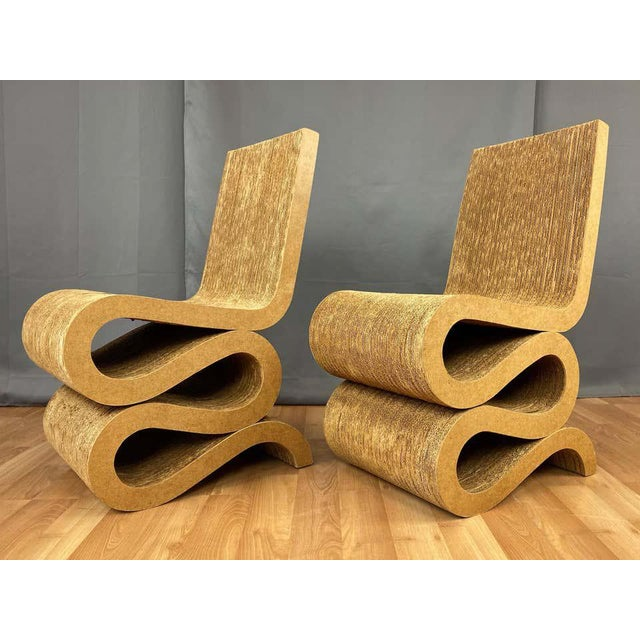 A rare pair of early 1970s Wiggle side chairs by Frank O. Gehry from his innovative and iconic Easy Edges collection of...