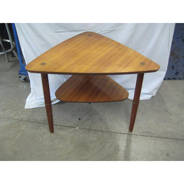 Mid-century 1960s rare guitar pick two tiered table made in Denmark by Kresten Buch. This table has beautiful brass leg...