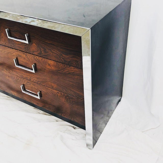 Stunning Vintage Mid Century Modern Dark Rosewood Panel and Chrome Framed Dresser, complete with 9 drawers and original...