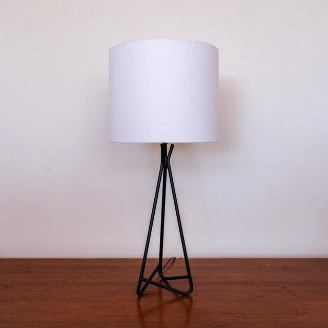 """Sculptural midcentury table lamp from the 1950s. Rewired. New linen shade measures 12"""" x 10""""."""