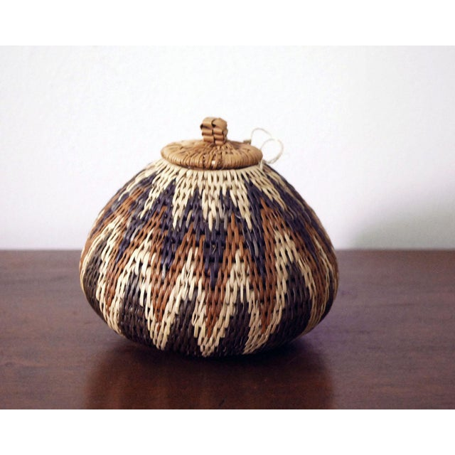Exquisitely hand woven vintage African seed basket, a traditional folk art of the Zulu people of South Africa. The basket...