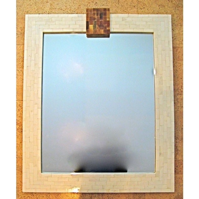 Modern Mirror veneered with polished Bone tiles surmounted by a Horn keystone.