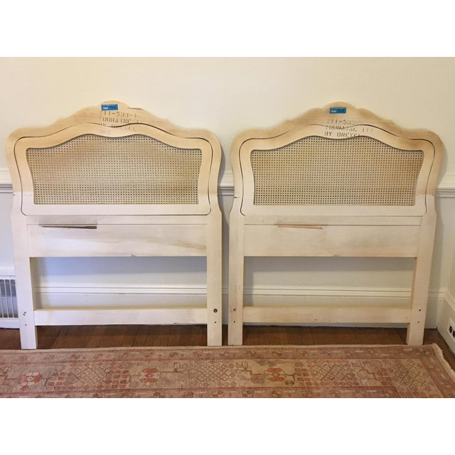 Two twin size headboards by Drexel Heritage. These French Provincial headboards are edged in gold and the cane is in...