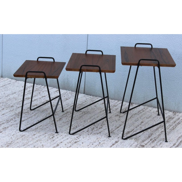 Stunning set of 1950s Tony Paul modernist nesting tables, newly refinished with teak top.
