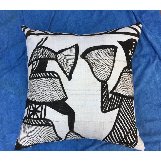 Custom pillow made with a hand woven African mud cloth with tribal pattern. Individual strips are sewn together to form...
