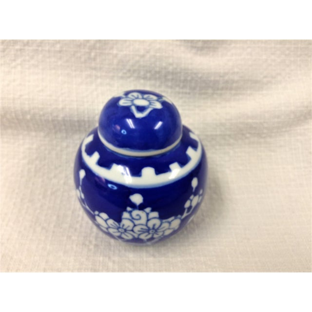 Miniature Ginger Jar This beautiful little ginger jar with lid is manufactured in China. It measures approximately 2 1/2...