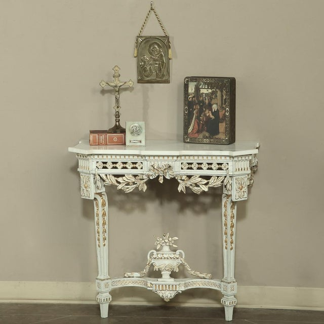 19th Century Swedish Neoclassical Marble-Top Painted Console features fantastic hand carved detail and pierce-carved...