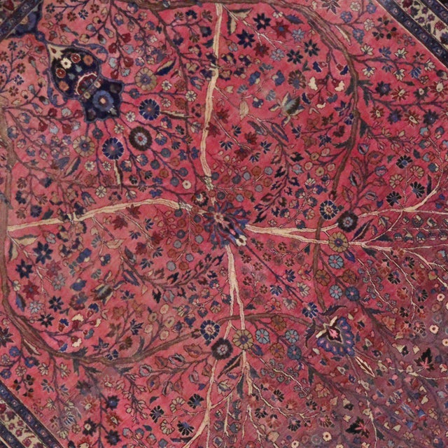 Opulent jewel tones enrich the lustrous composition of this grandeur antique Persian Mashhad (Meshed). An incredibly...