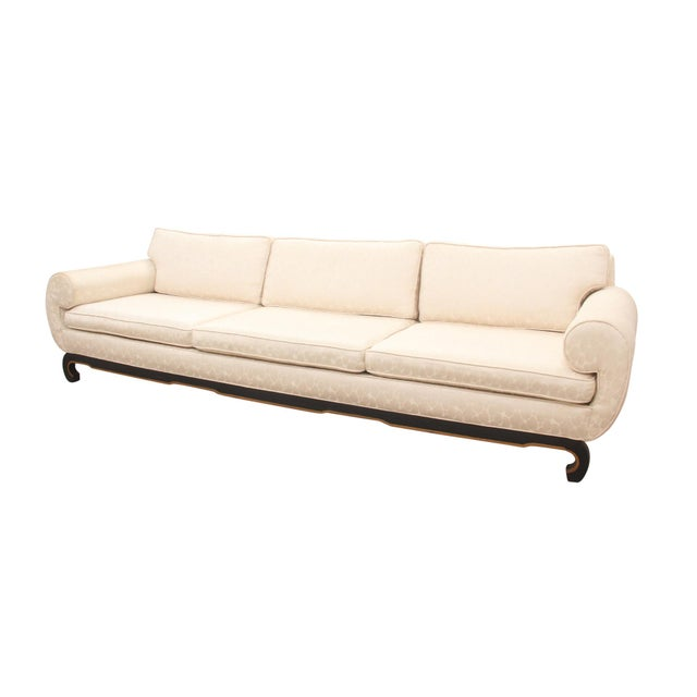 "Ming style three seat sofa in ivory ""champagne bubble"" fabric. Inward rolled scrolled arms flow down to the skirt. The..."