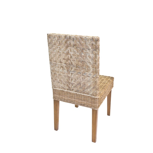 Our Boca Collection features this coastal style dining chair made out of all natural woven rattan on a solid rattan frame...