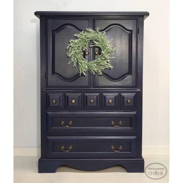 This three-drawer armoire / wardrobe has been refinished in deep navy with black glazing. The two shelves of the upper...