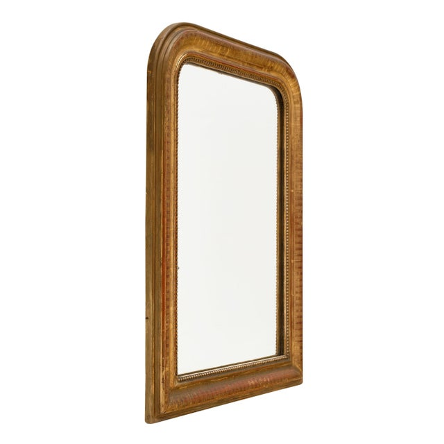 Louis Philippe period gold leaf mirror from the south of France with a beautiful hand-chiseled wood and gesso frame. The...