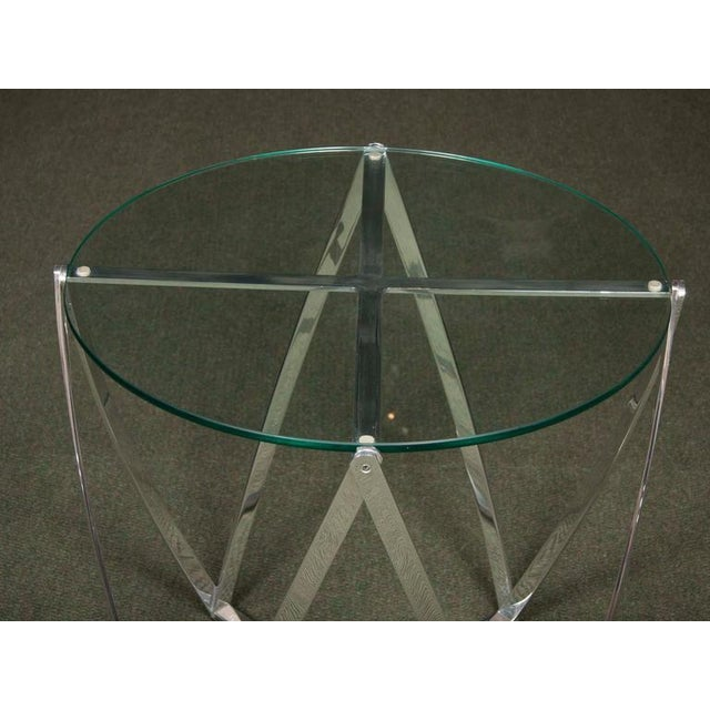 A f aluminum frame, round. glass-top side table designed by John Vesey from the mid 20th century.