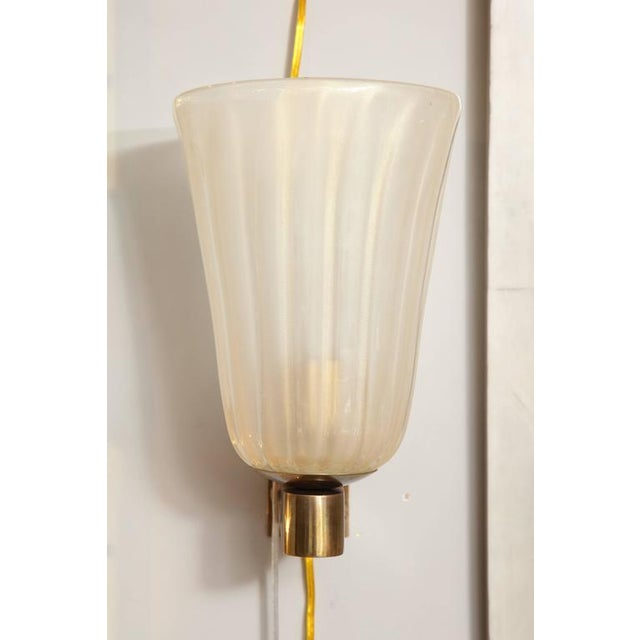 Pair of Murano glass and brass wall sconces.