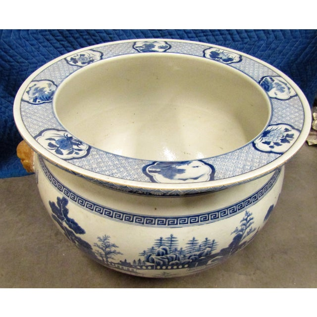 Large Antique Asian Urn in Blue and White with applied head handles. The Large urn has Asian designs and appear hand...