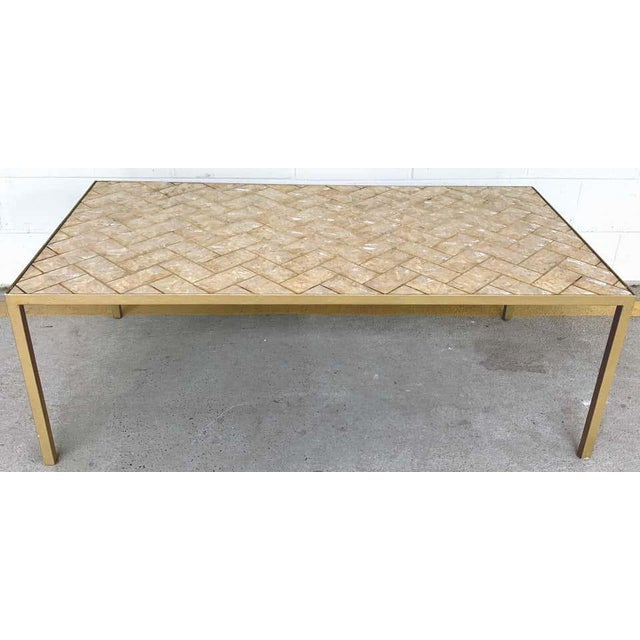 Maitland-Smith inlaid Capiz shell coffee table, good sized, with angled 'bricks' of Capiz shell and brass inlay, raise don...
