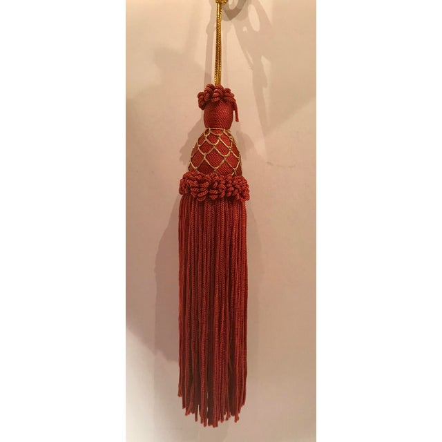 Nice wine colored with gold accents key tassel. Inside piece is wood. Came with a European cabinet. Perfect for keeping up...