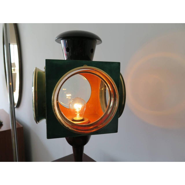This is an unusual lamp by Aldo Tura. The piece is shaped like a lantern and is made of lacquered goatskin, brass, and glass.