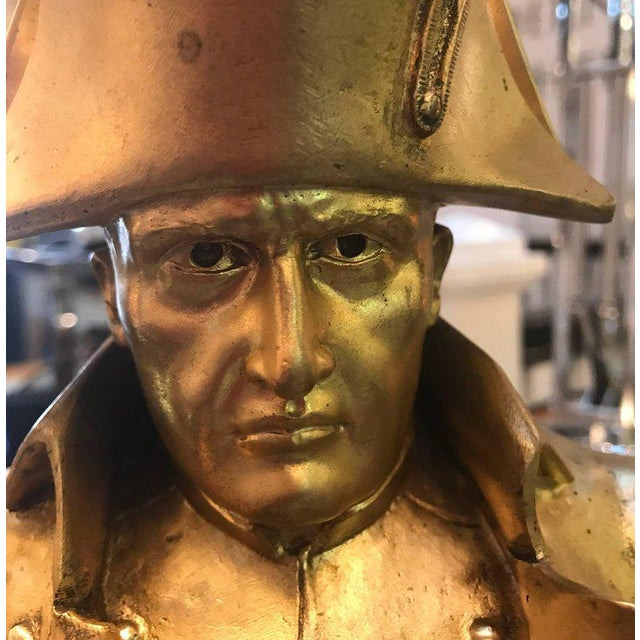 A gilt bronze bust of Napoleon, late 19th century with marble base. Cast bronze with a gold wash. Artist signed on back...
