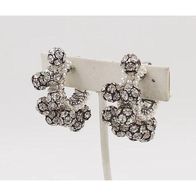 1960s silvertone wired resin faux-pearls with prong set clear rhinestone balls clip back earrings. Unmarked. Measure: 1.38...