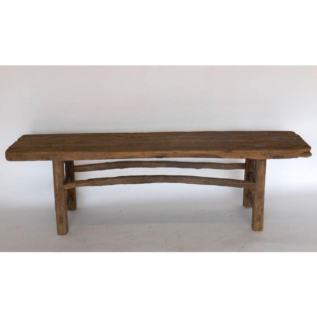 Beautiful Elm bench with natural branch stretchers. Mortise and tenon construction, beautiful old wood. Sturdy and...