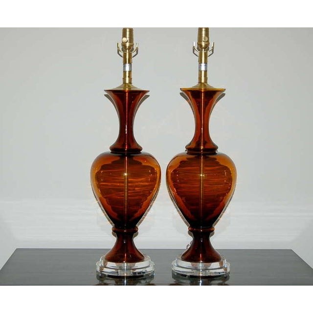 A matched pair of vintage Murano glass table lamps in COGNAC by The Marbro Lamp Company. The three-piece Venetian glass is...