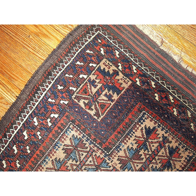 Collectible Afghan prayer Baluch rug with cream field and tribal design on it. This rug is prayer and in fair condition....
