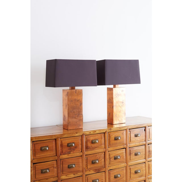 Stunning pair of table lamps by Arteriors Tanner Kenzie line of lighting. Features rectangular forms covered with copper...