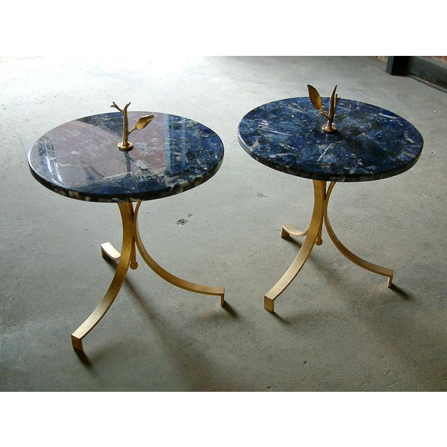 United States 1998 Forged and gilt steel occasional tables with Brazilian blue stone (Sodalite) laid over resin base.