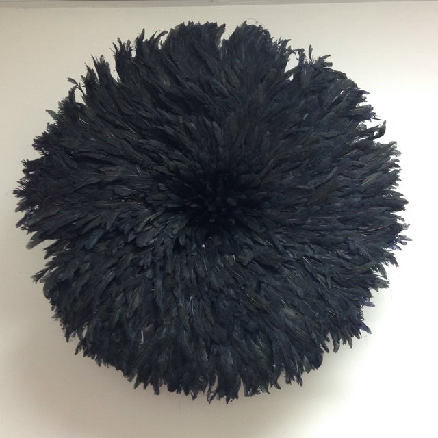The Juju hat (also known as Bamiléké feather headdress or Tyn Hat) symbolized prosperity. It is believed to possess the...