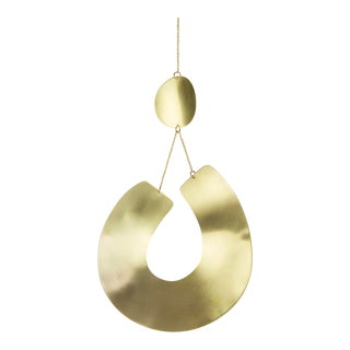 Brass Curved Relief Wall Hanging For Sale