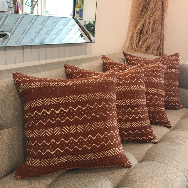 """Authentic African Mudcloth throw pillow in rust, 18"""" square. 100% cotton mudcloth. Linen blend backing in natural with..."""