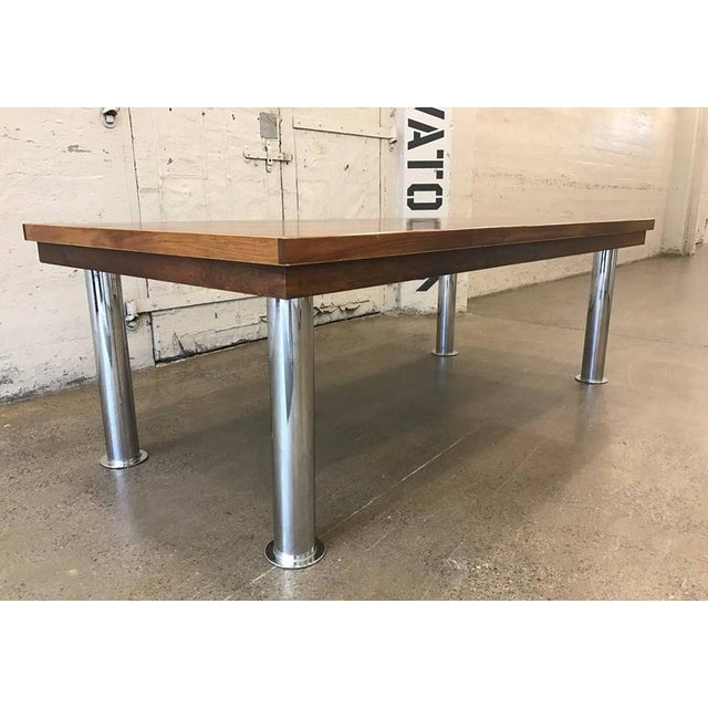 Mid-Century Modern rosewood and chrome conference table with cylindrical chromed steel legs. Industrial Table. Can also be...